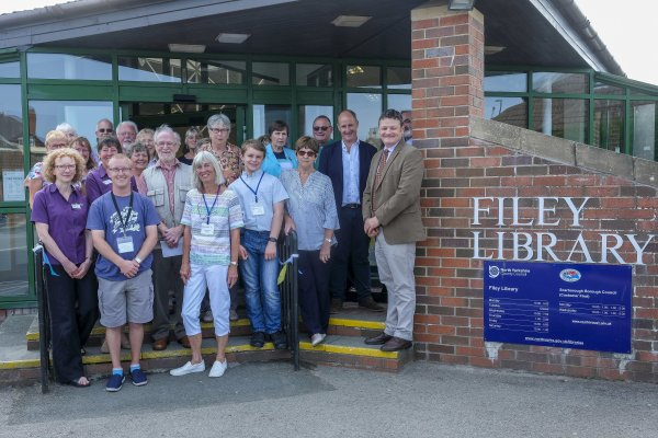 Library volunteers and staff with officials at the reopening ceremony