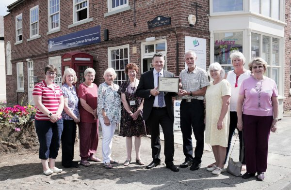 Cllr Greg White presents the North Yorkshire Library of the Year award to volunteers and trustees at Boroughbridge Community Library and Resource Centre. From left are, Shirley Cullimore, Julia Helliwell, Ros Helliwell, Barbara Horner, Anne Collins, Cllr White, John Helliwell, Helen Chester, Judith Burton and Shirley Dorman.