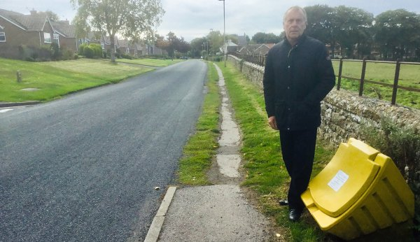 Cllr Derek Bastiman stands at the start of the stretch of footway that is to be upgraded