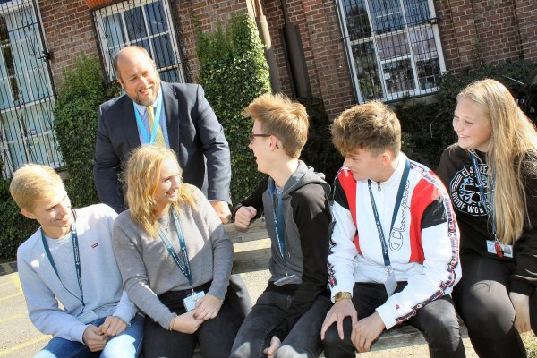 Principal Chris Drew with his sixth form students at Northallerton School and Sixth Form College