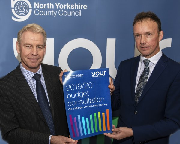 North Yorkshire County Council chief executive Richard Flinton and Corporate Director Strategic Resources Gary Fielding with a poster for the Your Services Your Say consultation