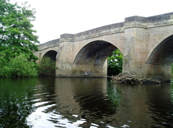 Grade II listed Masham Bridge spanning the River Ure.