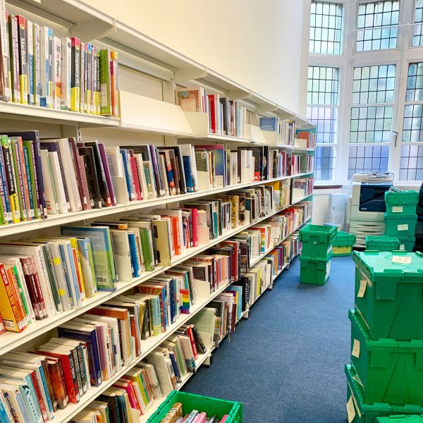 restocking the shelves at Skipton library