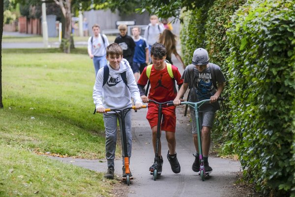 pupils scooting to school
