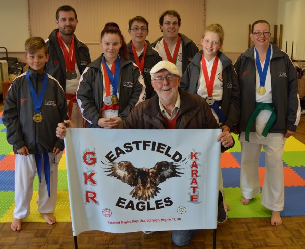 Pictured, members of the Eastfield Eagles Dojo, who qualified for the GKR Karate World Cup, with Cllr Tony Randerson