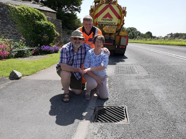 Linda and Rob Baines with Ringway gully operative Simon Mole at the drain