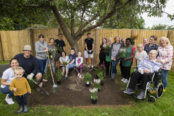 Friends, residents and staff working on Station View's new garden.