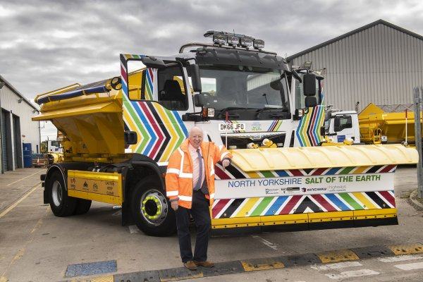 •	County Council Leader Cllr Carl Les with the gritter that took part in the UCI publicity caravan