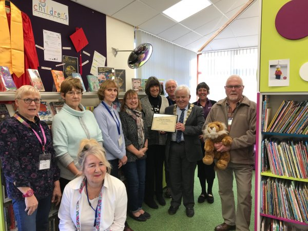 Library staff and volunteers at Filey library receive a Summer Reading Challenge award from Cllr Jim Clark