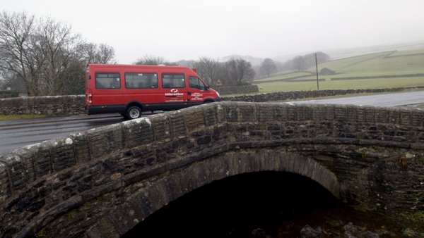 Bus driving over a bridge in North Yorkshire
