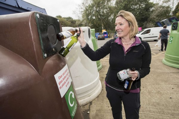 Lady recycling bottles at Northallerton HWRC