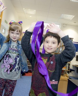 Gracie-May Robinson and William Slinger pull the bow to relaunch officially Gargrave and Malhamdale Community Library