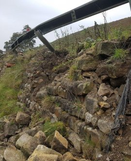 The crash barrier and retaining wall were badly damaged in an accident involving a heavy goods vehicle
