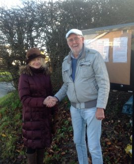Osgodby Parish Council chair Councillor Christine Jones with County Councillor Tony Randerson next to one of the new noticeboards