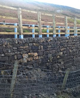 The repaired crash barrier and retaining wall on the A59 at Kex Gill.