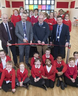 With pupils at the opening ceremony are, from left, former headteacher Grahame Shepherd, County Council Corporate Director of Children and Young People's Services, Stuart Carlton, and Philip Gallagher, senior site manager for Walter Thompson, with headteacher Ian Mottram.