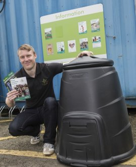 Jeff Coates, volunteer coordinator with the County Council's waste and countryside services, shows off a home composting bin.