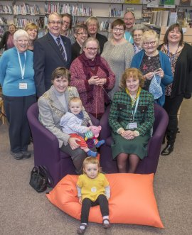 Cllr Helen Swiers (seated, left) and Cllr Elizabeth Shields (seated, right) celebrate the success of Norton Hive Library and Community Hub with volunteers, councillors and members of the Stronger Communities team.