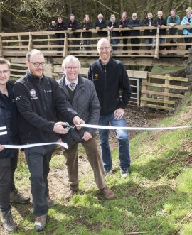 Phil Tennyson (Yorkshire Water), Simon Bassindale (North York Moors National Park), Tim Swales (Osmotherley Parish Council) and Graham Gaunt (North York Moors National Park) at the launch of the bridge at Cod Beck Reservoir