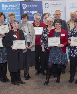 Representatives of community libraries being recognised for their achievements in the Summer Reading Challenge at last year's libraries conference.