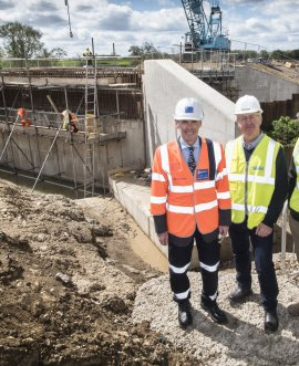 Work on the new Dalton Bridge progresses watched by (from left) County Councillor Don Mackenzie, Hambleton District Council Leader Councillor Mark Robson and Roy Fishwick, representing the group of businesses backing the bridge scheme