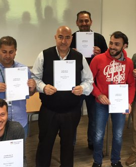 The refugees at Harrogate College with their certificates.