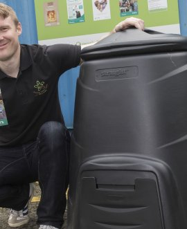 Man with compost bin.