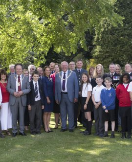 County Council chair Cllr Robert Windass (centre) with service personnel, children from the Military Kids Clubs and other guests at County Hall.
