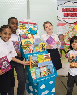 Children promoting the summer reading challenge.