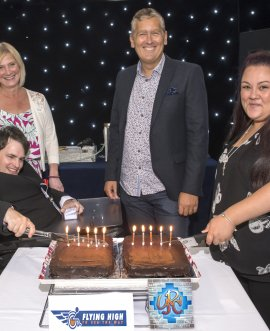 2.	Cutting the cake at the 10th anniversary are Oliver Griffiths and Natasha Firth, original members of Flying High and the Young People's Council respectively, with Stuart Carlton, the County Council's Director of Children and Young People's Services, and Jane Le Sage, Assistant Director for Inclusion.