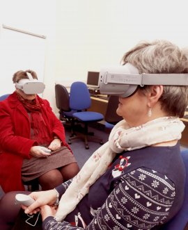Two users at Harrogate Library try out the Virtual Reality headsets