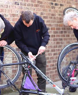 Volunteers busy fixing bikes outside the community workshops in Thirsk