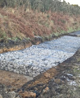 The first landslip caused a crack across the road which was dug out and gabion baskets (metal cages) containing stones were installed