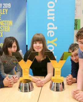 Mowbray School children with Tour de Yorkshire  trophies