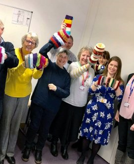 Twiddle muffs are passed on to voluntary agencies and community groups at the Dementia Friendly Richmondshire meeting
