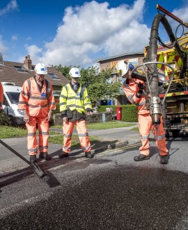 Contractors use jetpatcher to repair the road surface