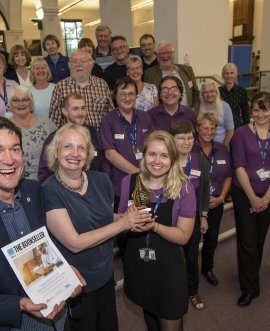 Benedicte Page presents the award to library supervisor Abigail Tanner with Fraser Hutchinson of the Reading Agency and staff and volunteers from Harrogate library and local authors