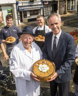 Pictured, Ian Weatherhead and North Yorkshire County Councillor Don Mackenzie,  Executive Member for Highways, with a pork pie similar to the one planned for the road race