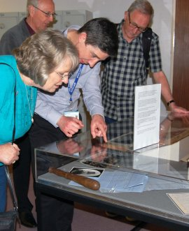 Visitors are shown archives relating to the early police force of North Yorkshire during an Archives at Dusk event