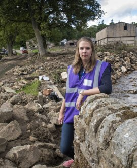 : Grace Lawes of the County Council's resilience and emergencies team sees the impact of flooding at a farm in Arkengarthdale