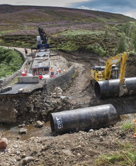 Steel tubing rolled into place at Grinton Moor