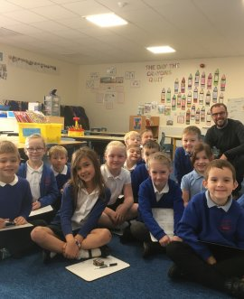 Teacher Andrew Price with Year 1 and 2 pupils