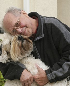 an elderly man with his dog