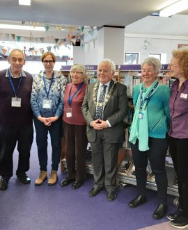 County Council chairman Cllr Jim Clark alongside staff and volunteers at Pickering library