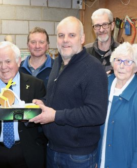 Members of the Whitby Area Sheds project and Cllr Jim Clark with a model of the sculpture they are planning to create. From left, Graham Storer, Malcolm Watson, North Yorkshire County Council chairman Jim Clark, Steven Marsh, Ian Wallis, Brian Holliday, Veronica Foster and Maggie Kilpatrick at the Sheds project in Staithes