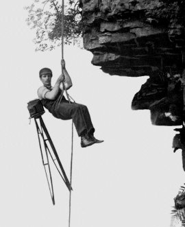•	Photograph of Cherry Kearton hanging off a cliff with his camera attached to his back, it shows the lengths the brothers went to get the perfect shot.